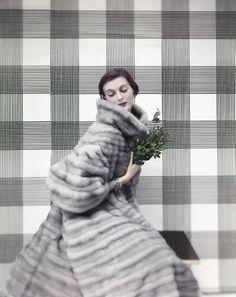 Carmen Dell'Orefice wearing a silver mink coat, 1954. Photo by Virginia Thoren.