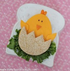 Cute Food For Kids?: Easter Sandwich: It's a ham and cheese sandwich! Cut bread, cheese and ham with egg shape cookie cutter. Cut the cheese with cookie cutter; cut the bread and carrot with scissors. Tips: If you are packing this sandwich into a lunch box, don't forget to use some cream cheese to glue the wings and beak on the chick! I use sesame seeds for the eyes.