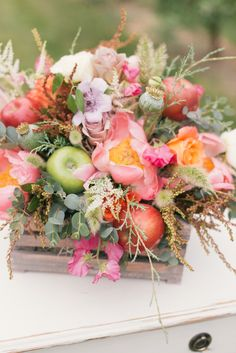 Centerpiece with pink peony and apples | Hannah Truly Photography and Pink Paisley Events | see more on: http://burnettsboards.com/2014/07/wedding-planners-engagement/