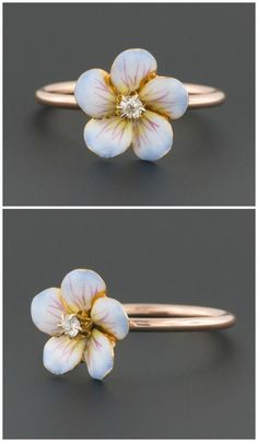 A ring made from a converted antique pin. The flower is enamel, with a diamond center. #jewelryrings #antiquejewelry