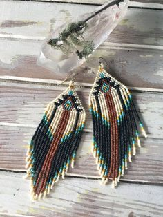Magical & earthy, Native American inspired seed bead fringe earrings. Traditionally Native American women adorned themselves with seed bead earrings for their weddings.  Length: 6 inches Width: 2 inches  Light weight, easy to wear, prefect for any occasion, effortless beauty, earthy vibes. ***each pair is handmade to order & colors may vary slightly from original photo***  ***send Moss & Moon a message if your interested in custom earrings!***  ***first time customers get 20% off their first…