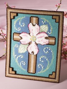 Plastic Canvas - Holiday & Seasonal Patterns - Spring Patterns Lift your spirit with this beautiful symbol of Easter. Worked in soft colors and delicately accented with French knots, this picture is truly glorious. Plastic Canvas Coasters, Plastic Canvas Crafts, Plastic Canvas Patterns, Diy Canvas, Wall Canvas, Canvas Ideas, Hama Beads, Beautiful Symbols, Bible Covers