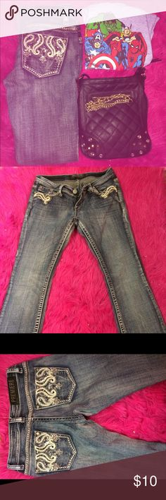 Rue 21 jeans Super cute and in great condition. No signs of wear or tear look brand new! Has a lot of cute detail in all of the pockets Rue 21 Jeans Boot Cut