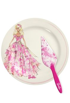 The perfect serving accessories for your birthday cake! Featuring a Robert Best illustration of Birthday Wishes® Barbie® Doll, this Barbie Cake Plate and Server Set is the perfect finishing touch to a beautiful celebration.