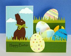 handmade Easter card from Curt's World blog ... side step card format ... Chocolate die cut bunny ... eggs and die cut grass borders ...