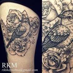 Floral tattoo by Riki-Kay, with roses and daisies. Bird done in etching style on a thigh.