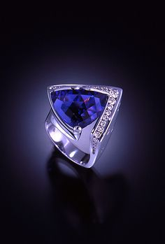 I love Tanzanite, and with diamonds and this unusual cut....just beautiful.