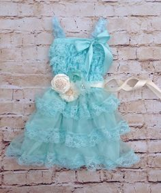 This beautiful aqua blue lace dress would be great for many different occasions. It is very soft and stretchy, and looks pretty in photos as