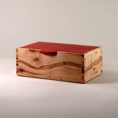 Figured (ambrosia) maple sides, box joint corners, and contrasting (bright red) oak top.