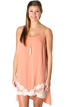 Peach hi-low dress with split sides and crochet detailing (fully lined and adjustable straps). Conor is wearing a size Small.
