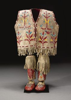 Sioux Child's Beaded and Quilled Hide Outfit, the vest, with an American flag motif on the back and floral designs on the front, trimmed with narrow panels of beadwork, together with a pair of leggings and moccasins.