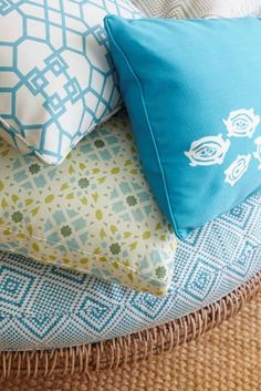 Windsor Smith Home for Kravet. Pictured: pillows going clockwise: Kanekopa, Kura Kura, Moloko, and Kapaa. Ottoman fabric: Kanekopa.