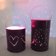 Repurposed tin can lanterns - Follow @Guidecentral for amazing #crafts and #DIY ideas