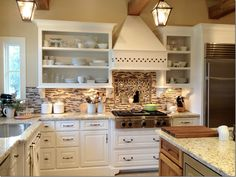 I want to do this to my next kitchen and the back of the shelves I want to add subway tile it will look so beautiful!!