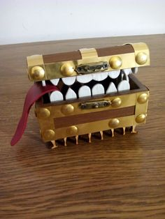 Small Wooden Luggage, chest, trunk with teeth and legs fitting with Brass. Box Jewelery