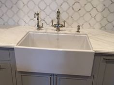 A ROHL Water appliance featuring a Shaws #Farmhouse Fireclay Kitchen Sink, a Perrin & Rowe Filtration Faucet and our new Perrin & Rowe Hot Water Faucet was just installed in a new project from QualCraft Construction http://www.rohlhome.com/