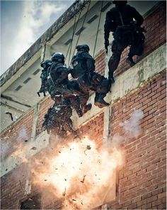 SWAT Reppeling down the side of a building.