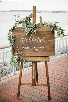 13 calligraphy ideas for your wedding. Love this wedding welcome sign with calligraphy script and green florals.