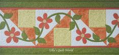 Table runner quilt with flowers by Ulla's Quilt World.