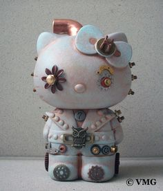 """Custom vinyl 6"""" Steampunk Hello Kitty mixed media assemblage.  Contains antique clock and watch parts, brass jewelry castings and hardware, acrylic paint, varnish, wood and other found objects.  This is a unique, one-of-a-kind (OOAK) custom urban vinyl art toy.  **Warning** This piece is no..."""