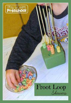 Play to Learn Preschool - Froot Loop Skewers - sorting by color