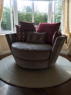 135 cm wide x 130 cm deep wide swivel based snuggler for two.  This was a great solution for a large bay window.