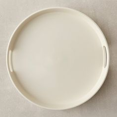 """First popularized in eighteenth-century England, creamware has long been a pretty and practical staple for serving and dining. We worked with a small Italian manufacturer to update classic, creamware serving shapes with a modern matte glaze. This streamlined tray makes a perfectly understated addition to the table.- Ceramic- Hand wash- Italy1.5""""H, 15"""" diameter"""
