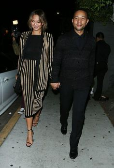 For a date with husband John Legend, pregnant Chrissy Teigen wore a matching black-and-gold striped skirt and jacket. Click for more of her best maternity style moments so far