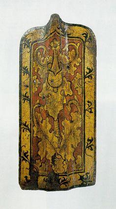 historicum.net 1446/1455 Inv.Nr. W 3858  Die Pavesen genannten Setzschilde dieser Größe waren für Fußkämpfer, kleinere wurden auch von Reitern geführt. Prag und Komotau sind als Herstellungsorte für die prachtvoll bemalten böhmischen Pavesen bekannt.