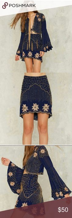 Nasty Gal Collection Bead Your Love Skirt New! Never worn. Metallic beading and floral embroidery throughout, scalloped hem, asymmetric silhouette, hidden side zip closure, and mini skirt lining. Skirt only Nasty Gal Skirts Asymmetrical