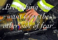 Everything you want is on the other side of fear i love this with the manicured fingers.  Female firefighter