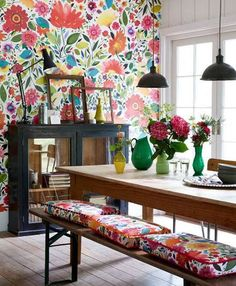 The Wallpaper Accent Wall Is The Budget-Friendly Decor Idea You Need To Try - Flower printed dining room wallpaper with farm table and flower cushions