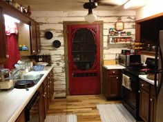 My country kitchen with old wooden siding on one wall from my parents first house. My husband did it all including screen pantry door.