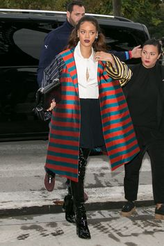 Stripes on stripes...on stripes? For many, Rihanna's busy Dior Haute Couture coat could be a fashion faux pas—but because she looks good in literally anything, this statement piece looks chicer than ever on the singer as she steps out in Paris.    - MarieClaire.com