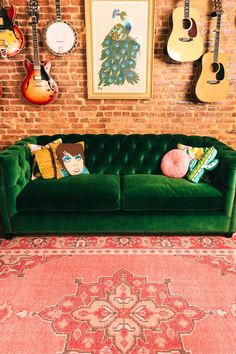 Green velvet couch with music accents.