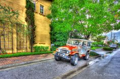 I saw this rusty old Toyota Land Cruiser as I was on my way to a photo shoot.  I had to stop and capture this image with HDR photography.  It brings out so much of the visual texture in the rust spots, the wall and the leaves in the background - even the water is brought to life.  #Toyota #Landcruiser #FJ40
