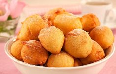 Bolinhos de Chuva are a signature treat in Brazilian dessert making. They are deep fried golden dumplings covered with cinnamon and powdered sugar.