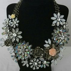 """Beautiful Statement Necklace Beautiful statement necklace. Floral accent rhinestone with white bead accents. High quality.Silver plated chain with 2.5"""" extender. Velvet bag included. Kimberly's Boutique Jewelry Necklaces"""