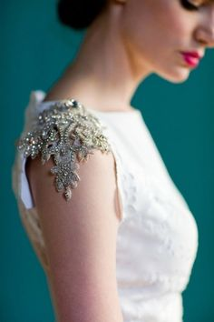 White dress with gold embroidered lace sleeves