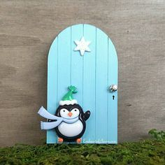 This cute little penguin is all set for winter as he waits outside the magical icy blue fairy door for his fairy friends to come out and play!     #fairygarden #miniaturegarden #minigarden #fairy #fairydoor #miniature  #terrarium #garden #blue #winter #penguin #snowflake #christmas #dollhouse #etsy #handcrafted #etsygifts #etsyseller #smallbusiness #craftbusiness