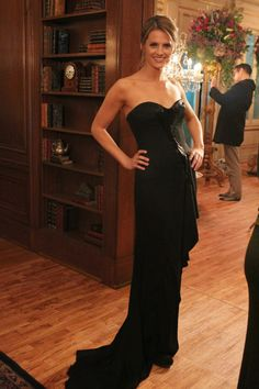 Stana Katic. If I went with a black dress, this would be a perfect choice.