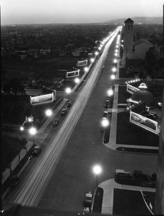 """- Aerial view of a well lit Wilshire Boulevard at night. The ORIGINAL BROWN DERBY restaurant is visible on the right. Note the numerous signboards on both sides of Wilshire Blvd. The """"Wilshire Special"""" streetlights do a good job lighting up the Boulevard. California History, California Dreamin', Vintage California, California English, Brown Derby Restaurant, Usc Library, Las Vegas, San Fernando Valley, Cinema"""