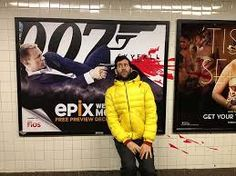 Jon Burgerman was in a subway & saw this billboard for the new James Bond 007 movie in 2014, he stand next to it & had a friend take a picture of him acting like he is been shot in the head & by using Photoshop to put the texture of the blood. i like this because he made the red look like real blood photoshop & like Daniel Craig actully shot him.
