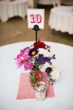 Another interesting centerpiece! We have lots of mason jars leftover from June's Garden Party inspired event.