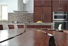 Grabill custom kitchen cabinets inspired by a custom Rosewood dining table.