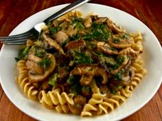 Mushroom Stroganoff= Healthy | 1 large yellow onion, 8 ounces crimini/ other wild mushrooms, 8 ounces sliced mushrooms, 4 cloves garlic, 4 tablespoons whole-wheat flour, 3 tablespoons balsamic vinegar, 1/2 cup soy milk, thyme, 16 ounces cooked whole-wheat fettuccini noodles