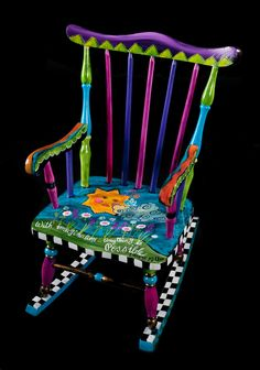 A whimsical customized childrens rocking chair, created from a reclaimed rocker.
