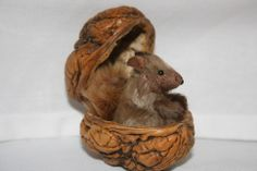 I made this from one of my extra large walnuts and a tiny vintage squirrel