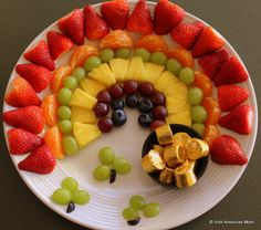 A fruit rainbow with a rolo pot of gold - a perfect play date treat coming up to St. Patrick's Day.