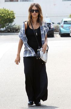 Jessica Alba street style with black maxi dress and plaid shirt. #jessicaalba